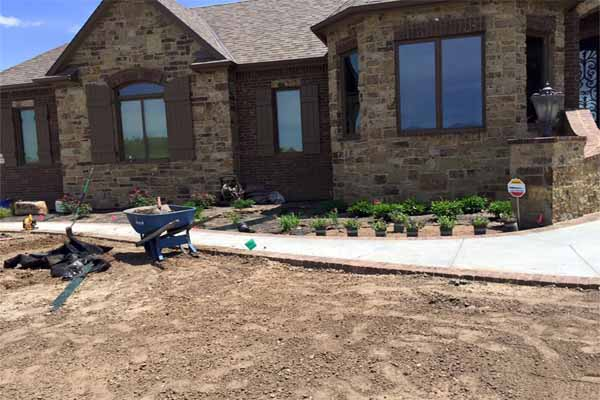 A Boston area home improvement project doesn't usually include landscaping your new home, but it should.